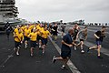 U.S. Sailors participate in a 5-kilometer run on the flight deck of the aircraft carrier USS Nimitz (CVN 68) in the Gulf of Oman Aug. 25, 2013 130825-N-LP801-037.jpg