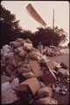 UNCOLLECTED TRASH SPILLS OVER INTO THIS STREET ON THE OUTSKIRTS OF BIRMINGHAM - NARA - 545494.tif