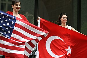 Turkish Americans - Turkish Americans holding the flags of the United States and Turkey