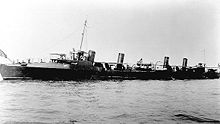 A black and white image of the Truxtun in open water.