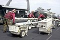 US Navy 030211-N-6817C-001 Aviation Ordnancemen move Advanced Medium Range Air to Air Missiles.jpg