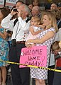 US Navy 030501-N-7032B-001 Family and friends eagerly await to welcome home sailors during the homecoming of Carrier Air Wing Fourteen (CVW-14) at Naval Air Station (NAS) Lemoore.jpg