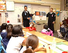 a respiratory therapist teaches students about the dangers of smoking