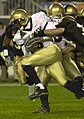 US Navy 031206-N-9693M-523 Navy wider receiver Jeremy McGown powers past Army defensive back Rob Davis during the 104th Army Navy Game.jpg