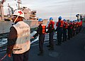 US Navy 040309-N-4374S-003 Sailors assigned to the guided missile frigate USS Taylor (FFG 50) hold steady on a messenger line during a Replenishment at Sea (RAS) with the fast combat support ship USS Seattle (AOE 3).jpg