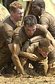 US Navy 040518-N-9693M-006 Midshipmen wrestle to find a photo buried in mud as part of Sea Trials.jpg
