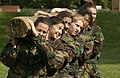 US Navy 040518-N-9693M-015 A squad of Midshipmen work with a log as part of teamwork training during Sea Trials.jpg