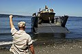 US Navy 050728-N-1056B-010 Sailors assigned to Beachmaster Unit One directs a landing craft delivering equipment and supplies to Naval Magazine Indian Island to prepare for the Joint Logistics Over the Shore exercise (JLOTS).jpg