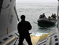 US Navy 060508-N-4021H-119 Sailors assigned to Naval Special Clearance Team One (NSCT-1), prepare to dock in the well deck aboard experimental boat ship Stiletto.jpg
