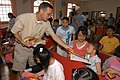 US Navy 060624-N-5334H-039 Seaman Christian Shields hands out coloring books to children at the Jinhae Jae-Hual-Won Orphanage for Handicapped Children.jpg