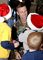 US Navy 061205-N-XXXXW-003 Naval Mobile Construction Battalion One (NMCB-1), Executive Officer, Lt. Cmdr. Eric J. Hawn, greets his three children after returning from the battalion's six-month deployment to the Far East.jpg