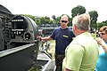 US Navy 070511-N-7154R-008 Special Operator 1st Class David Brodrick explains the interior details of a SEAL Delivery Vehicle to interested onlookers as part of Public Service Recognition Week (PSRW) held on the National Mall.jpg