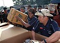 US Navy 070602-N-2296G-007 Hospital Corpsman 1st Class Allen Yabut (right), unpacks medical supplies and hands them off to Hospital Corpsman 2nd Class Crystal Ruff, at the beginning of a Medical Civic Action Project at Kaum Pur.jpg