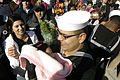 US Navy 080125-N-0486G-007 Culinary Specialist 2nd class Eber Varrazh hugs his newborn baby girl for the first time after he walked off the brow of The Guided-Missile Cruiser USS Vicksburg (CG 69).jpg