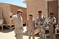 US Navy 080620-N-9623R-232 Lt. Scott Bender, from Casa Grande, Ariz., assigned to Naval Mobile Construction Battalion (NMCB) 17, gives members of the Iraqi Army a tour of the newly completed combat outpost located in the Iraqi.jpg