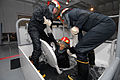 US Navy 080819-N-6936D-124 Sailors assigned to the amphibious assault ship USS Essex (LHD 2) work together to help a shipmate exit from a flooding space.jpg