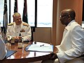 US Navy 090406-N-8273J-050 Chief of Naval Operations (CNO) Adm. Gary Roughead, left, meets with Deputy Minister of Defense Mr. Fezile Bhengu, right, during a conference call at the Defense Headquarters in Pretoria, South Africa.jpg