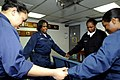 US Navy 090416-N-7478G-112 Participants in the amphibious command ship USS Blue Ridge (LCC 19) women's Bible study group pray during a weekly Bible study while the ship is underway.jpg