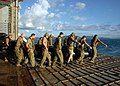 US Navy 090708-N-8487G-002 Members of a Royal Australian clearance diving team carry a combat rubber raiding craft on to the stern gate of the amphibious transport dock ship USS Denver (LPD 9) before a training exercise.jpg