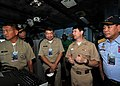 US Navy 090810-N-6233H-123 Rear Adm. Kevin Donegan, center right, commander of Battle Force 7th Fleet, speaks with Vice Adm. Golez, Vice Adm. Marayag and Adm. Tamayo on the navigation bridge during a visit aboard the aircraft c.jpg