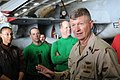 US Navy 090912-N-4995K-141 Master Chief Petty Officer of the Navy (MCPON) Rick West speaks to Sailors assigned to the Black Knights of Helicopter Anti-Submarine Squadron (HS) 4 in the hangar bay of the aircraft carrier USS Rona.jpg