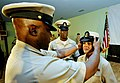 US Navy 090916-N-0506A-122 Senior Chief Yeoman Leo Godet places a combination cover on Chief Information Systems Technician Delia Chang during a pinning ceremony for new Navy chiefs at Camp Lemonier.jpg