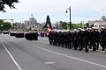 US Navy 100611-N-4005H-438 Sailors from six countries march toward the British Columbia Parliament buildings in a parade during the Canadian International Fleet Review in honor of the Canadian navy's 100th anniversary.jpg