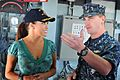 US Navy 111007-N-AW702-019 Lt. j.g. Rick Engel explains to Headline News morning anchor Robin Meade various operations that take place in the pilot.jpg