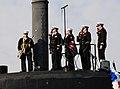 US Navy 111215-N-HG315-003 The bridge team salutes as they shift colors.jpg