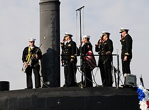 US Navy 111215-N-HG315-003 The bridge team salutes as they shift colors.jpg