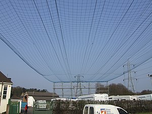 Safety net - A safety net over a roadway to protect cars during overhead cable replacement