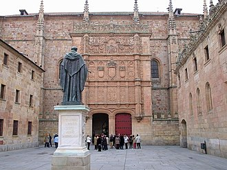 University of Salamanca - Plateresque façade of the University facing a statue of Fray Luis de León.