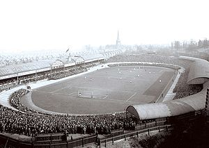 Villa Park - Villa Park during a match against Liverpool in 1907; the ground is yet to be squared off, and the cycle track can still be seen.