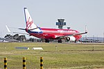 Virgin Australia (VH-VUR) Boeing 737-8FE(WL) taking off on runway 25 at Sydney Airport.jpg