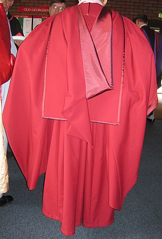 Academic dress of the University of Wales - The Wales PhD gown and hood with the divinity faculty silk.