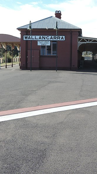 Wallangarra railway station - Wallangarra railway station with the state border marked in paint in the foreground, 2015