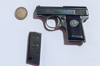 Walther Model 9 - A Walther Model 9 pistol with a loaded magazine and a 2 Euro coin