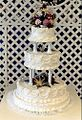 Wedding cake with pillars and floral decoration.jpg