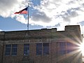Wenatchee Washington Downtown Fire Station- flag and sunset.jpg