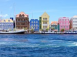 Port with colorful houses in blue, brown, green, yellow, pink.