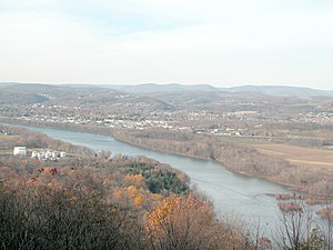 West Branch Susquehanna River - The eastern side of Williamsport, seen from the southeast on Bald Eagle Mountain. In the foreground is the West Branch of the Susquehanna River. Beyond Williamsport can be seen the higher part of the dissected Allegheny Plateau.