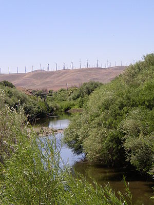 Walla Walla River - Wind turbines over the lower Walla Walla. River depleted by irrigation water withdrawal.