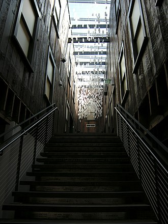 """East Kong Yick Building - Looking up the main staircase of the museum into a space that was originally an unroofed """"light well"""" between upper sections of the building."""