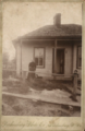 Woman and child with house by Parkersburg Photo Co of West Virginia.png