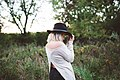 Woman in black hat on a meadow (Unsplash).jpg