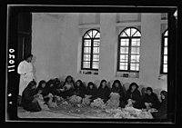 Women's Institute, Jerusalem. Group of women picking wool LOC matpc.19907.jpg