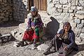 Women enjoying the sun in the streets of Kagbeni (15773687932).jpg
