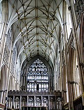 This interior view at York shows the Gothic style becoming less about projecting forms and more about surface treatment. The walls, vault and east window are all covered with a decorative net-like tracery. The pattern of the vault ribs resembles interconnecting stars.