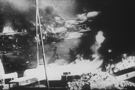 Barricades and Soviet tanks on fire (Srpen68)Horici barikady a tanky.jpg