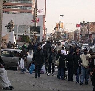 African-American neighborhood - Shopping on 125th Street, Harlem, New York City.